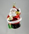 dicker Weihnachtsmann mit Glocke und Geschenk